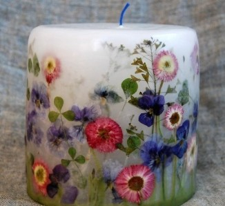 Homemade candle with dried flowers