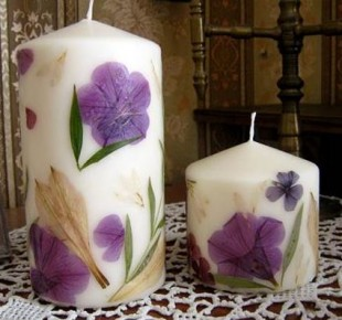 Homemade candles with dried flowers