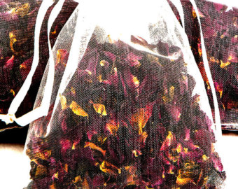 Making potpourri from dried flowers and herbs